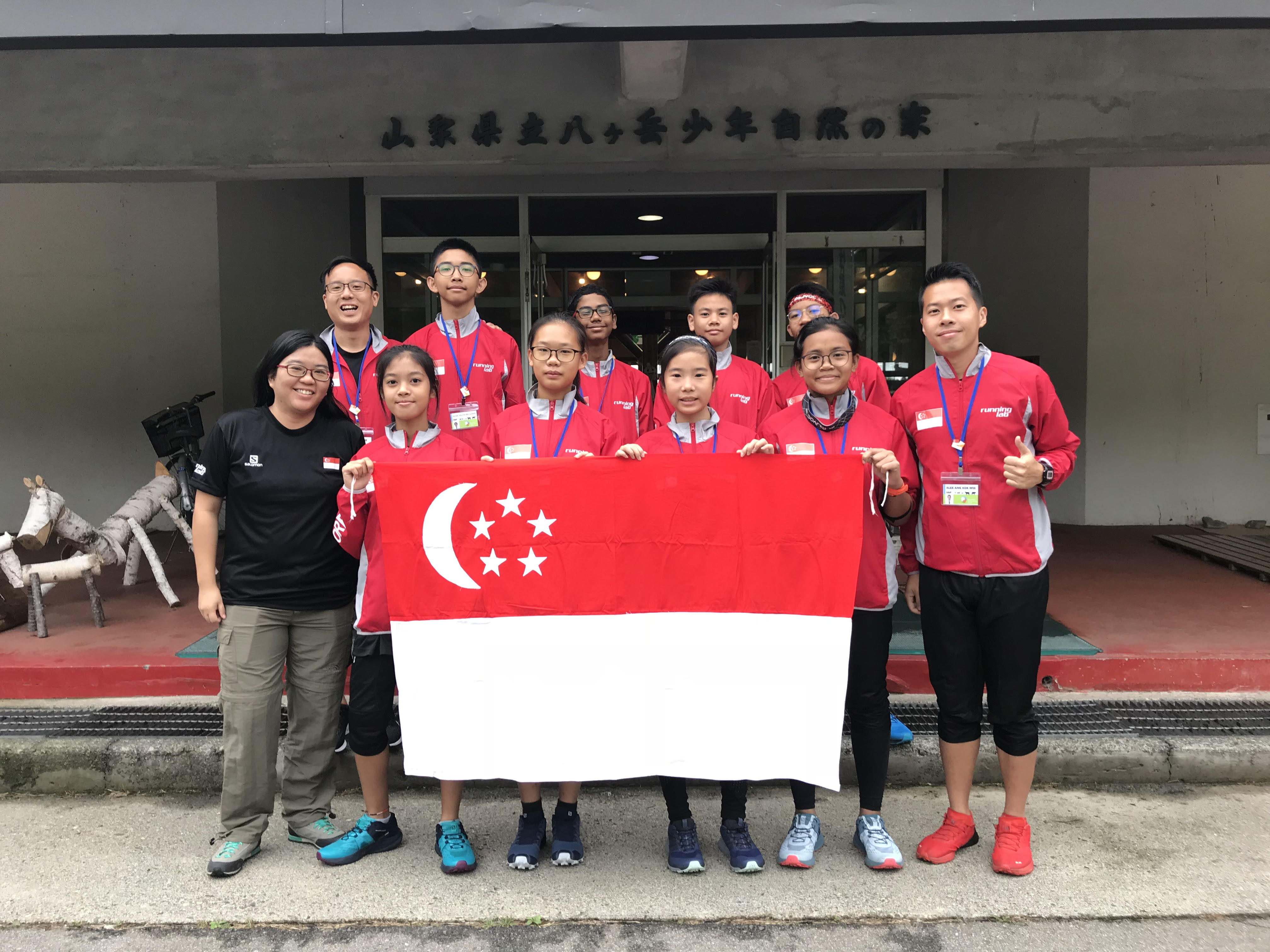 Mr Alex Ang and students at the 3rd Asian Junior and Youth Orienteering Championships, Japan (Photo taken before COVID-19.)