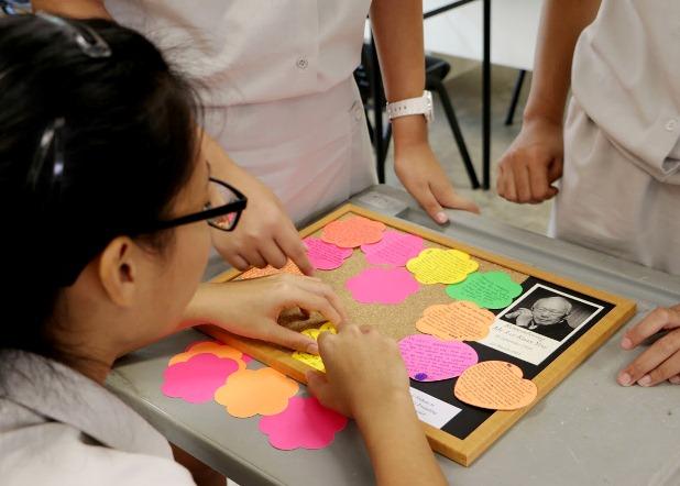 Students of Innova JC prepare a tribute board in memory of Mr Lee Kuan Yew