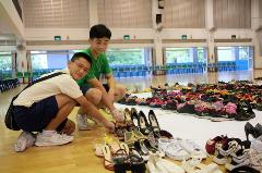 students-arranging-the-shoes (2)