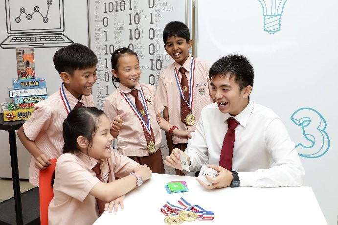 Mr Goh guiding students to play the multiplication flash card game